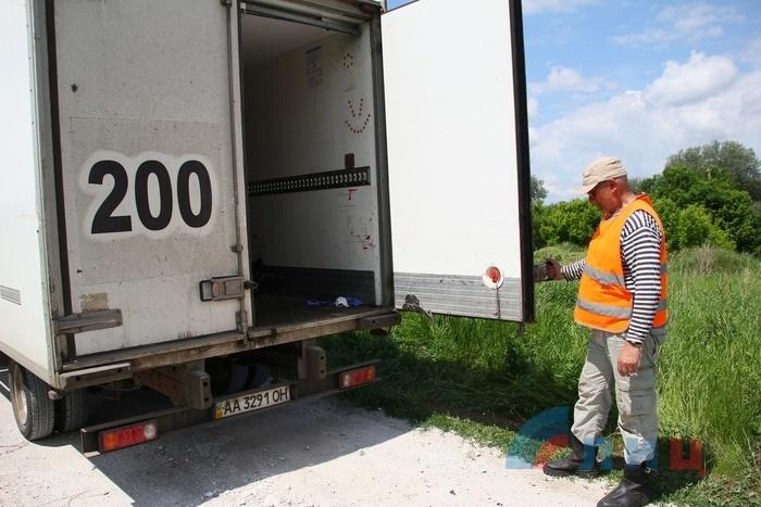 Эксгумация останков военнослужащего ВСУ, Раевка, 2 июня 2015 года